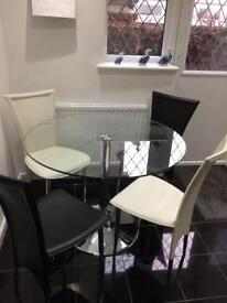 Round glass table and 4 chairs