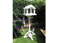 bird table in white free standing with house style shelter