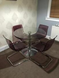 Glass table and 4 ikea chairs.
