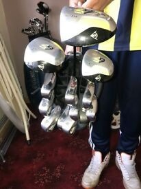 Dunlop 65 golf clubs with trolly and bag