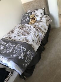 Single bed with headboard and mattress