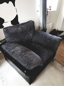 Excellent condition large sofa and cuddle chair black and grey part leather and cuddle pillows