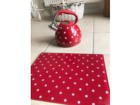 Unused red polka dot whistle kettle and matching glass chopping board.
