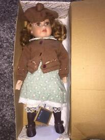 "Porcelain doll 16"" in original box"