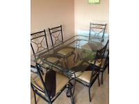 Glass table with 6 newly upholstered chairs