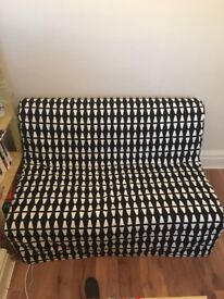 Futon/sofa bed with two different covers