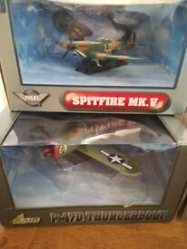 Collectable cars and planes in original packaging.