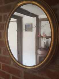 Edwardian brass framed oval mirror