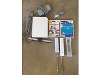 Nintendo Wii with Games and Remotes