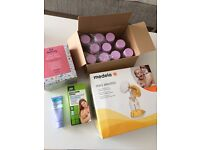 *Medela electric mini breast pump WITH EXTRAS*