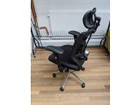 Ergonomic office chair with adjustable headrest