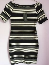 Brand new women's black and white stripy bodycon dress