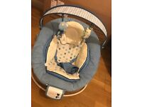 Blue baby bouncer with vibrate settings