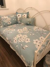 Single day bed with bedding and accessories