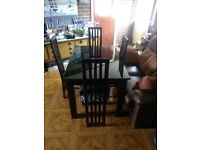 Dining Table Black Gloss. Excellent condition. Includes 4 chairs. Size 120cm x 83cm. 162cm extended