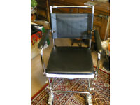 Wheelchair with built-in commode, 'Gliding Commode',
