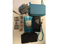 3Ds Bundle with: Console, 2Ds and 3Ds games, case, lead and charging dock.