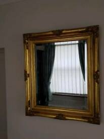 Gold coloured frame mirror