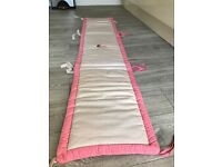 Baby girl cot bumper. In Excellent condition. Not used for long.