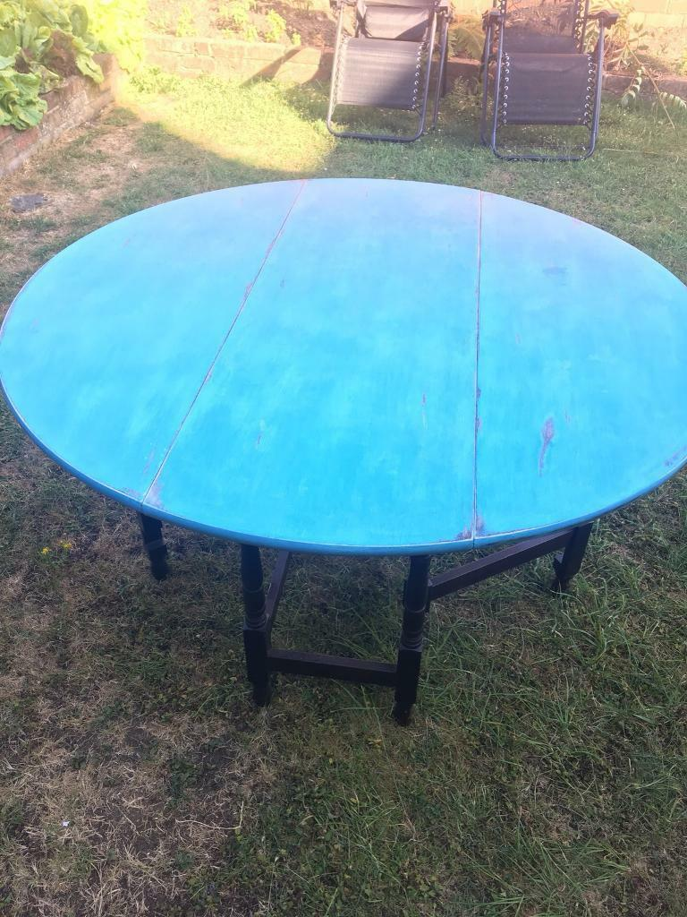 Round drop leaf table redland