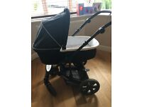 Black Britax B-Smart pram with mattress options and cover.