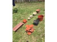 Large bundle of garden pots and planters
