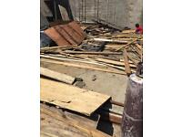Loads of brand new wood never used and roof tiles