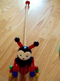 Tiddlytots wooden walker trolley stick push alongs rattle clown wheels Play & Learn