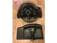 Xbox 360 steering wheel and pedals.