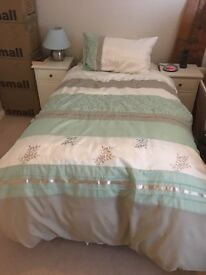 2 Single Beds With Underbed storage.