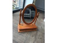Oval dressing table mirror in pine surround with vanity box.