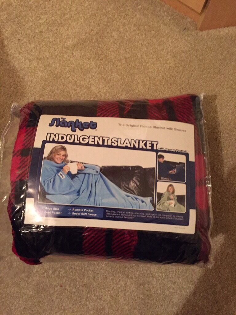 Tartan Slanket (Never usedin Chatham, KentGumtree - Indulgent Slanket Fleece blanket with sleeves Super soft, large size, foot pocket and remote control pocket Perfect relief from freezing winter days cosy indoor evenings The plastic zip up case has unfortunately suffered a large tear whilst it was...