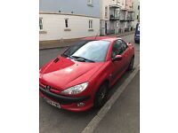 Red Peugeot 206cc 1.6 convertible, automatic