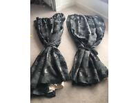 Black and silver flower lined curtains