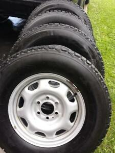 FORD F150 FACTORY OEM STEEL WHEELS WITH HIGH PERFORMANCE  FIRESTONE WINTERFORCE 265 / 70 / 17 WINTER TIRES.