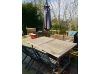 Big garden table with 6 chairs and umbrella