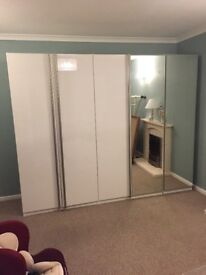 White gloss and mirrored wardrobes