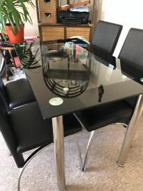 Glass table and chairs. Excellent