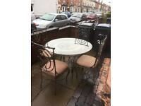 glass dining table with 4 lovely chairs great condition