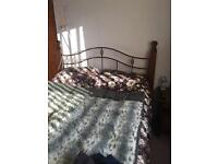 King size bed solid dark wood and iron