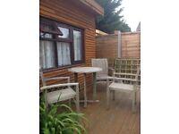 Lovely hardwood patio set