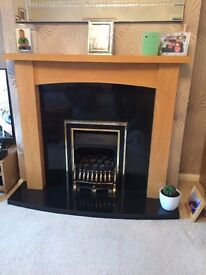 Granite fireplace with wooden mantle
