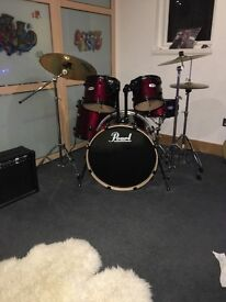 Red/black pearl drum kit. Very rarely been used. Great condition, includes new drum heads&stick