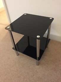 Small black glass tv table or coffee table with shelf