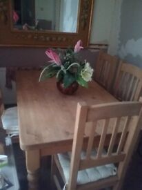 Unvarnished pine table and chairs