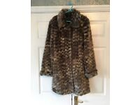 Lovely faux fur coat in perfect condition.