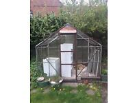 Large greenhouse garden storage unit with door and windows