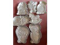 7 assorted Wilton cake tins(used) Troll. Mouse,Ninja Turtle,Cat,Rocking HorseBarney and Dinosaur