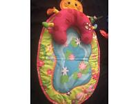 Playmat with tummy time cushion