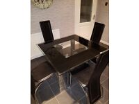 Glass dining table . Used but in good condition.